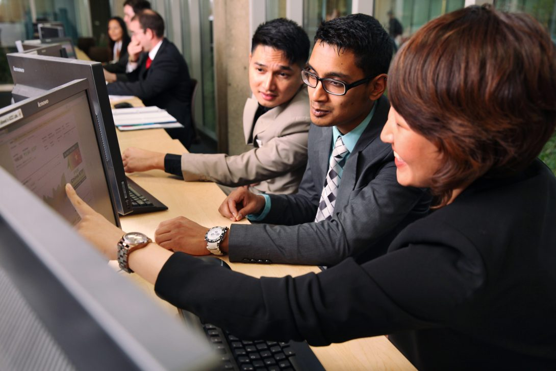 students working together on a computer