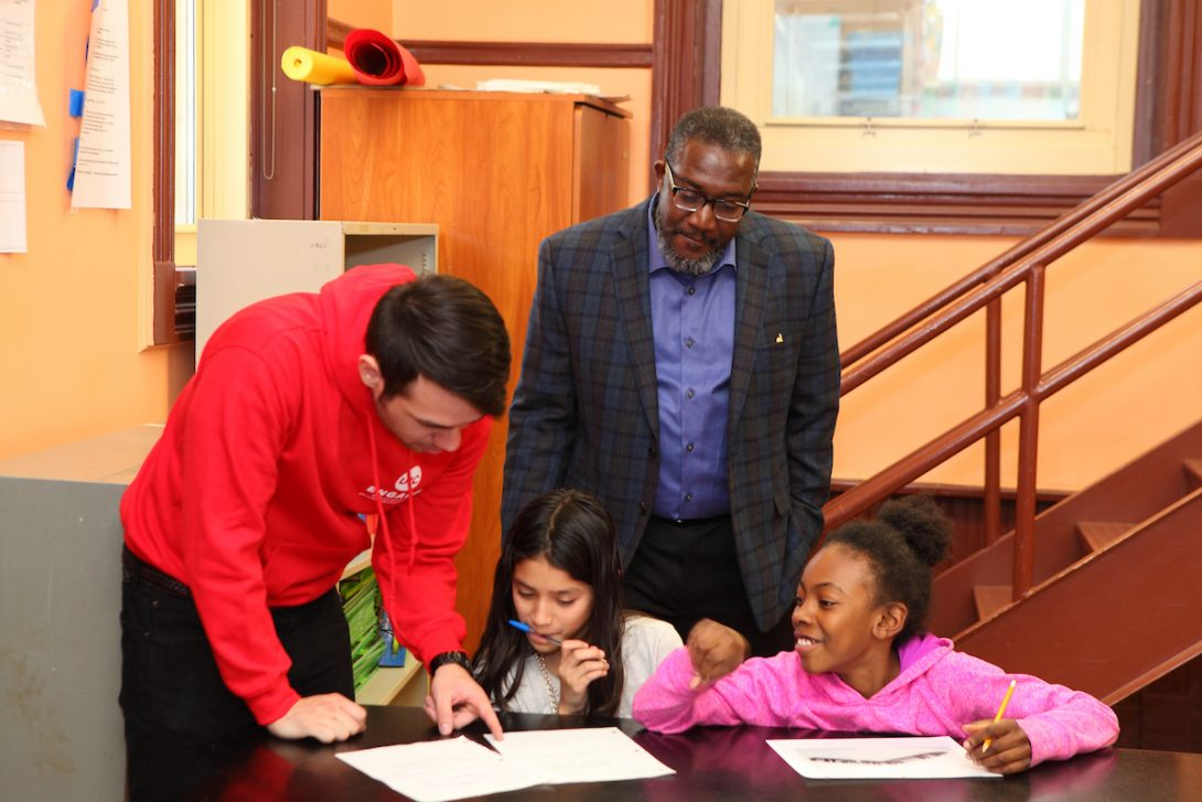 UIC student and CPS administrator tutoring students