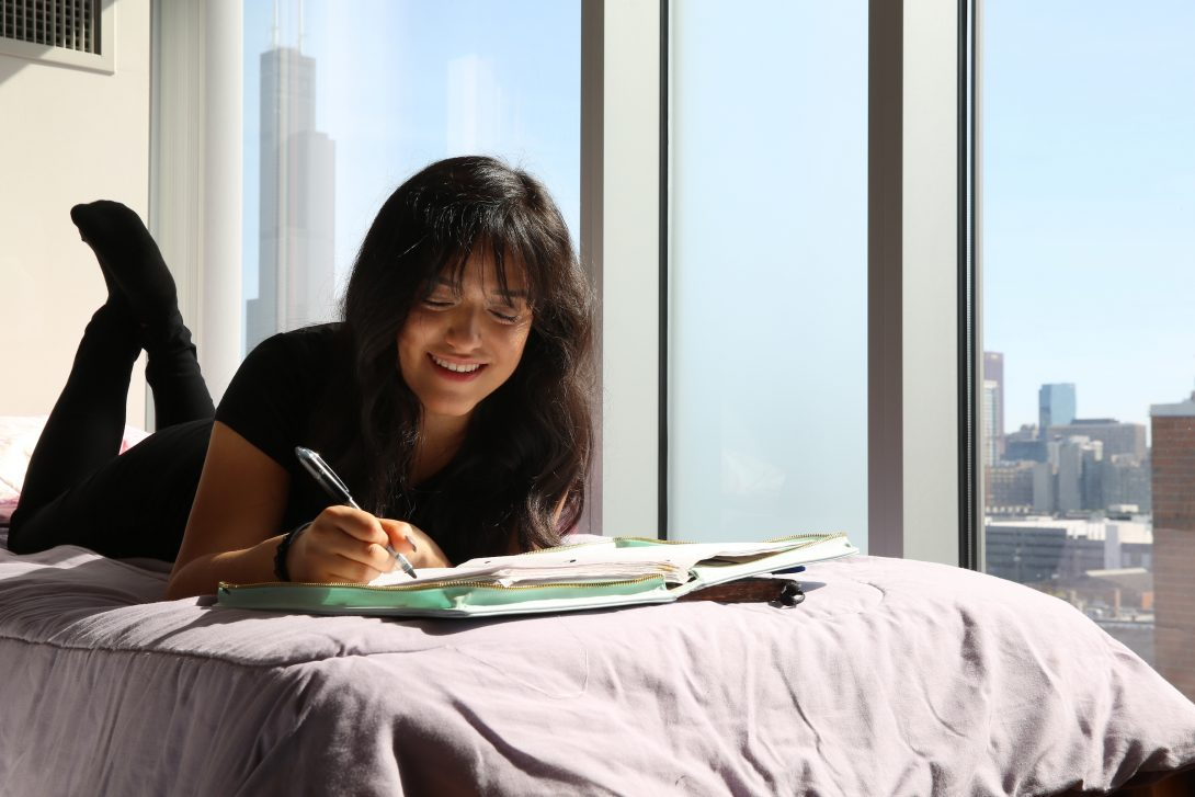 female student studying in residence hall bedroom