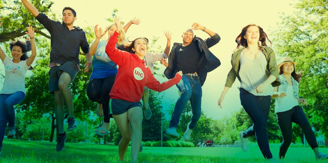 Happy Students running on Grass