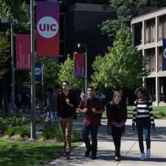 students walk through campus