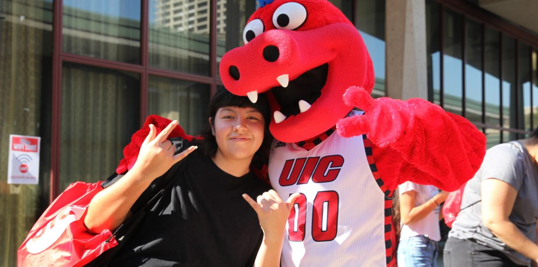 A student giving Pose with Sparky