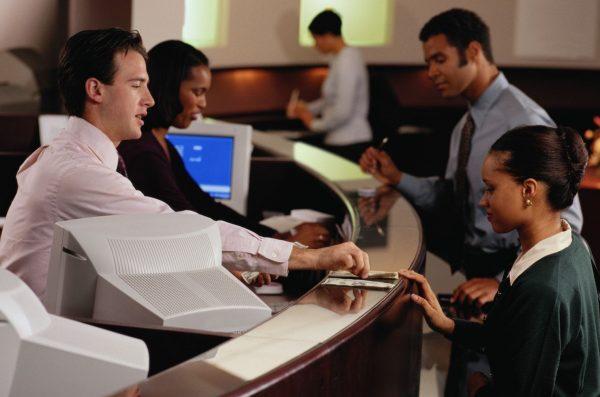 Bank teller exchange with customer